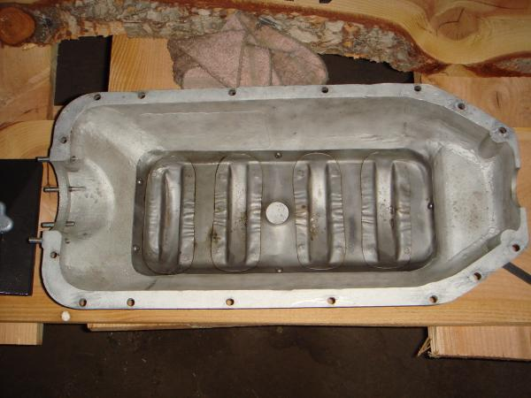 Cast aluminum oil pan & rod dipper tray.